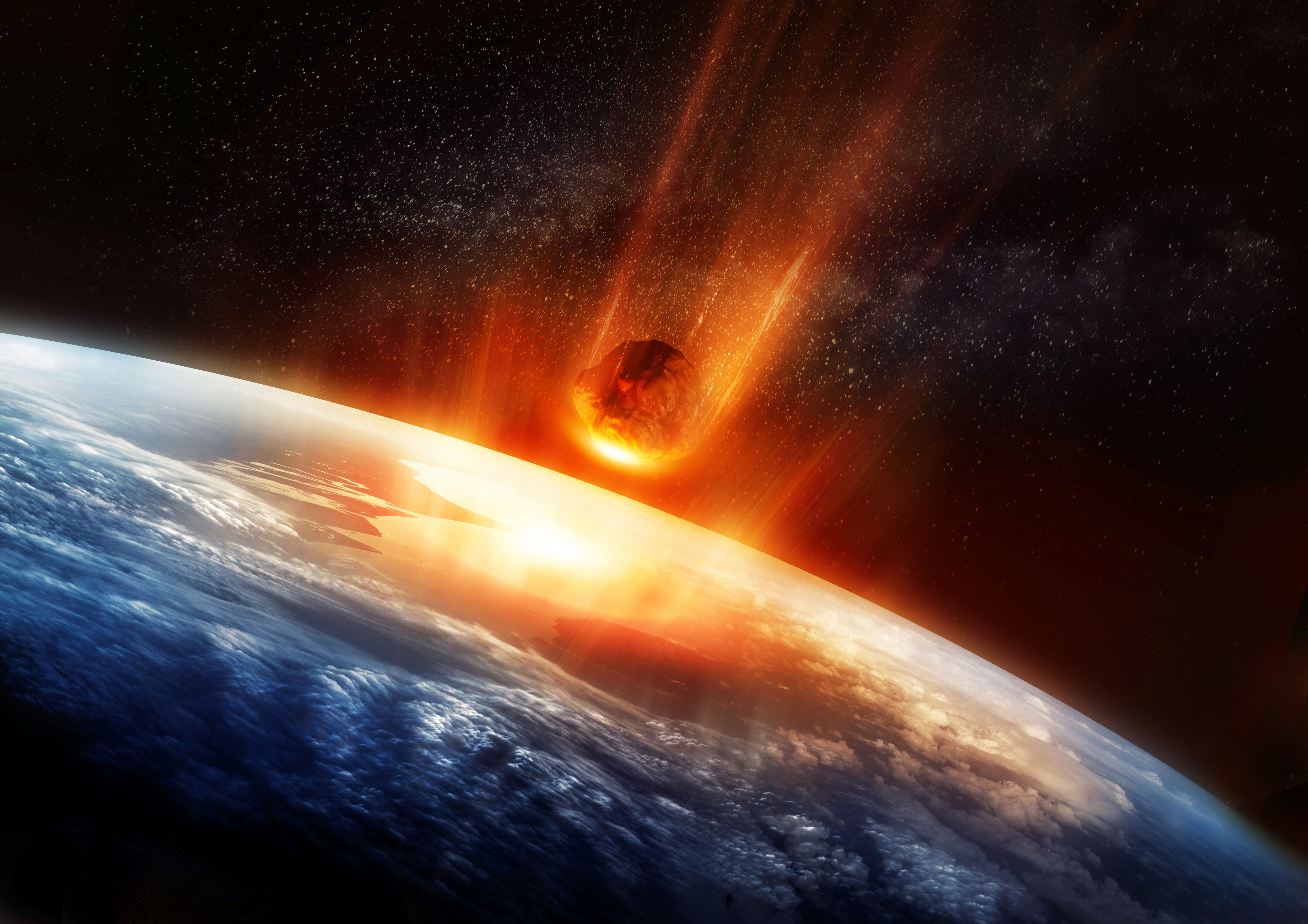 A large Meteor burning and glowing as it hits the earth's atmosphere. 3D illustration.jpg